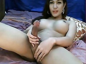 Beautiful tranny jerks off her big cock and cums