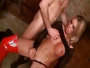 Tranny in red high boots fucks and gets fucked hard