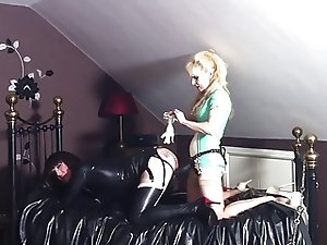 Latex Slut spanked & pegged by a rubber nurse!