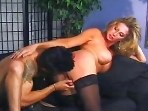 Naughty blonde shemale spanked and fucked
